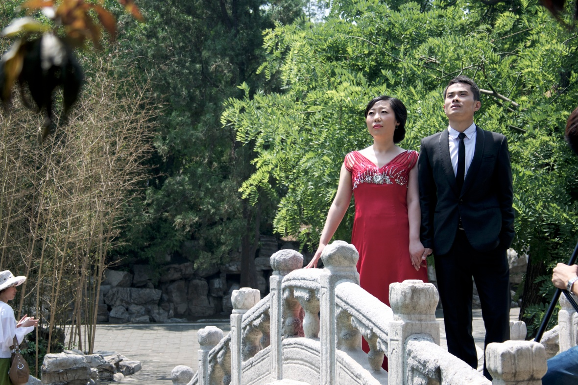 Wedding Day pictures in China. A woman wears a red dress because in China red is considered lucky. Photo Credit- Holly Lenny